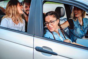 friends having fun in the car