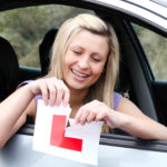 Learner driver tearing up L Plate after passing driving exam