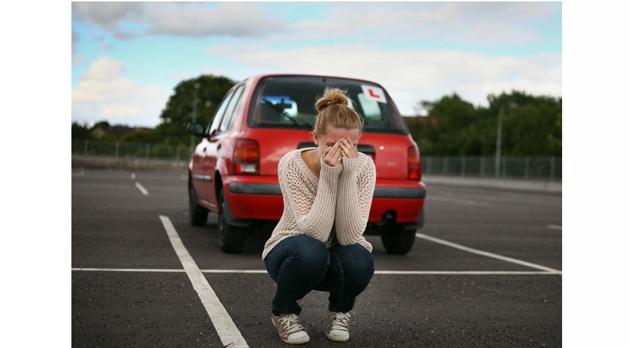 Woman crying outside learner car