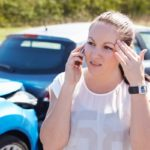 Girl on the phone after a car accident
