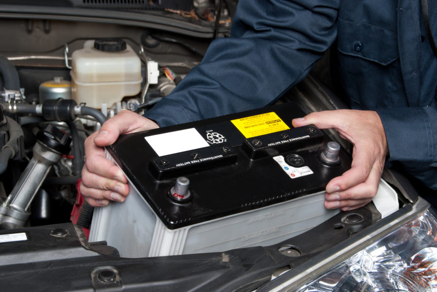 Mechanic changing a car battery