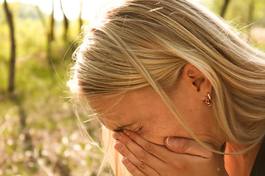 girl sneezing hayfever