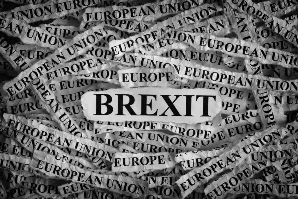 Brexit. Torn pieces of paper with the word Brexit. Concept Image. Black and White. Closeup. Photo 73543368 © Stepan Popov